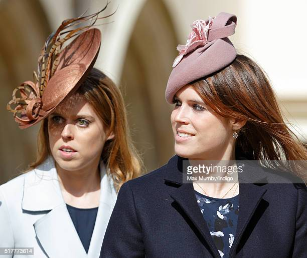 Princess Beatrice and Princess Eugenie attend the traditional Easter Sunday church service at St George's Chapel Windsor Castle on March 27 2016 in...