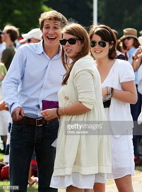 Princess Beatrice and Princess Eugenie laugh with Dave Clark Beatrice's boyfriend at the Vivari Queens Cup Final at Guards Polo Club on June 15 2008...
