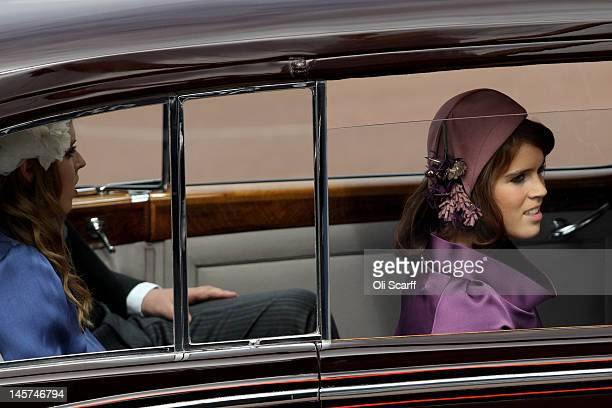 Princess Beatrice and Princess Eugenie leave Buckingham Palace during the Diamond Jubilee carriage procession prior to the service of thanksgiving at...