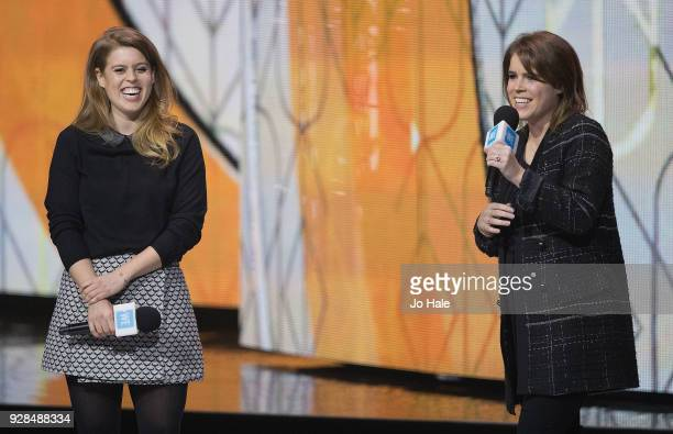 Princess Beatrice and Princess Eugenie on stage at We Day UK at Wembley Arena on March 7 2018 in London England