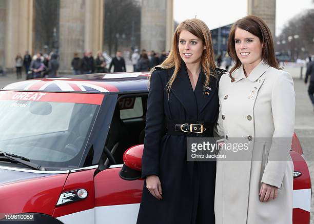 Princess Beatrice and Princess Eugenie pose next to a Mini in front of Brandenburg Gate as they promote the GREAT initiative on January 17 2013 in...