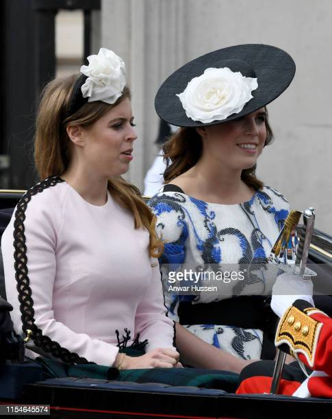 Princess Beatrice and Princess Eugenie ride in an open carriage as they attend Trooping the Colour on June 08 2019 in London England