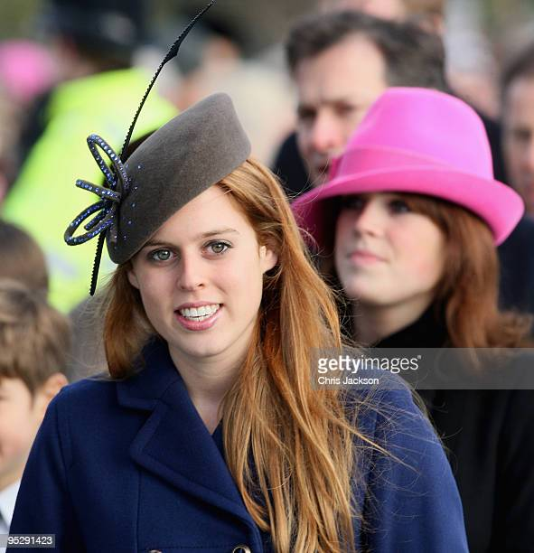Princess Beatrice and Princess Eugenie smile as they arrive for the Christmas Day service at Sandringham Church on December 25, 2009 in King's Lynn,...