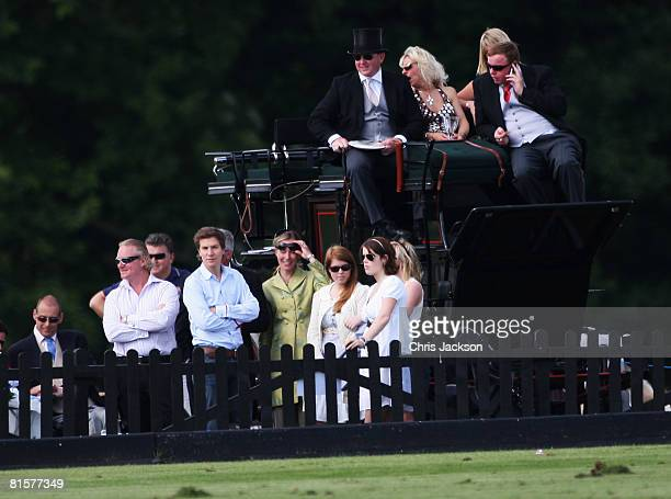 Princess Beatrice and Princess Eugenie stand with Dave Clark Beatrice's boyfriend at the Vivari Queens Cup Final at Guards Polo Club on June 15 2008...