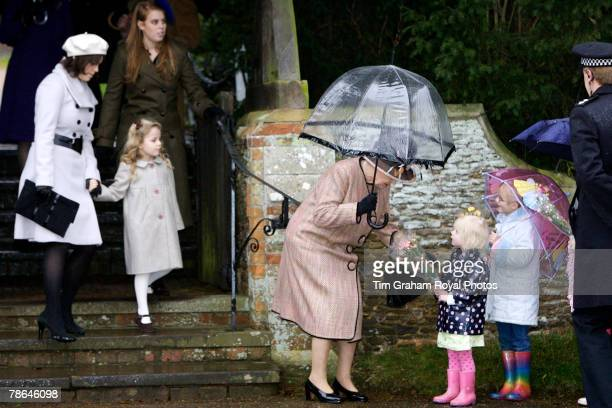 Princess Beatrice and Princess Eugenie with Margarita Armstrongjones watch Queen Elizabeth II meet children after Christmas Day service at...