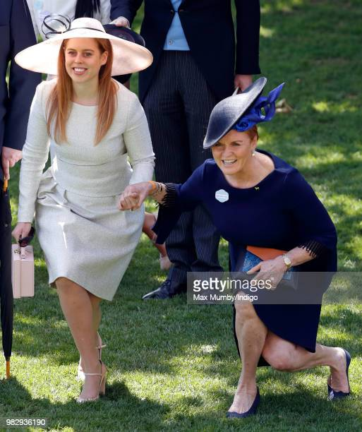 Princess Beatrice and Sarah Duchess of York curtsy to Queen Elizabeth II as she and her guests pass by in horse drawn carriages on day 4 of Royal...
