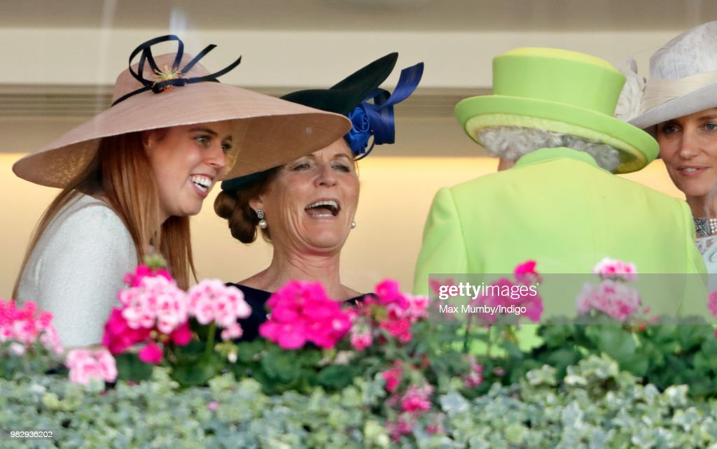 Princess Beatrice and Sarah, Duchess of York seen talking with Queen Elizabeth II in the Royal Box before watching The Queen's horse 'Elector' run in the King Edward VII stakes on day 4 of Royal Ascot at Ascot Racecourse on June 22, 2018 in Ascot, England.