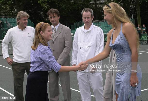 Princess Beatrice greets tennis player Anna Kournikova on Buckingham Palace tennis court before the start of the Duke of York's NSPCC Challenge...