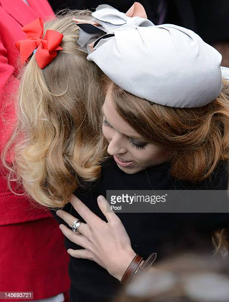 Princess Beatrice hugs the daughter of the Earl and Countess of Wessex at the start of the Thames Diamond Jubilee Pageant on the River Thames on June...
