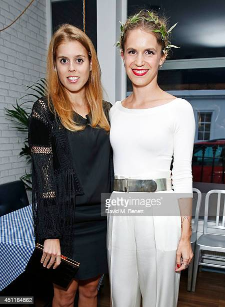 Princess Beatrice of York and Eugenie Niarchos attend Mazi's Summer Party with guest of honor Eugenie Niarchos Venyx World on June 24 2014 in London...
