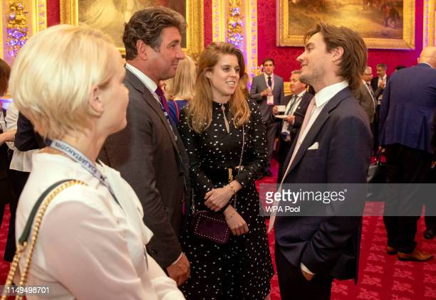 Princess Beatrice of York and her boyfriend Edoardo Mapelli Mozzi speak with guests during a Pitch@Palace event hosted by Prince Andrew Duke of York...