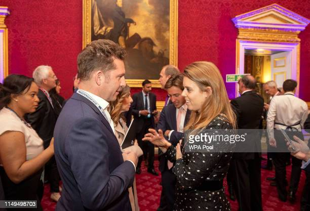 Princess Beatrice of York and her boyfriend Edoardo Mapelli Mozzi speak with guests during a Pitch@Palace event, hosted by Prince Andrew, Duke of...