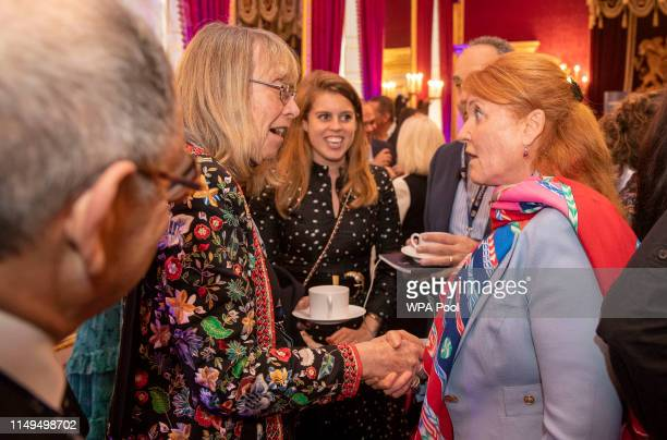 Princess Beatrice of York and her mother Sarah Ferguson Duchess of York speak to attendees at a Pitch@Palace event hosted by Prince Andrew Duke of...
