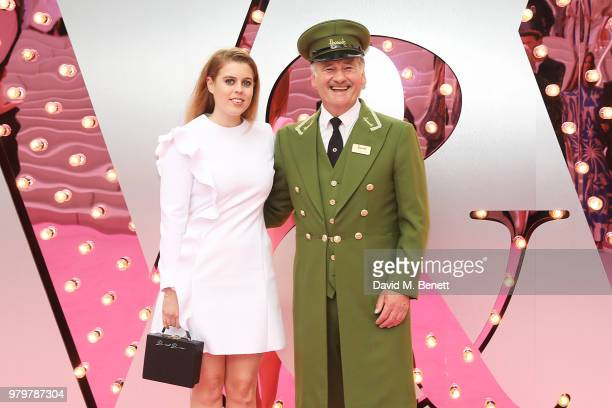 Princess Beatrice of York and poses with the Harrods Green Man at the Summer Party at the VA in partnership with Harrods at the Victoria and Albert...