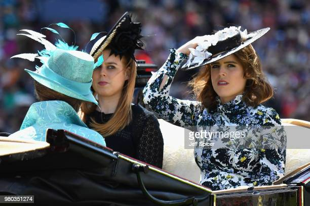 Princess Beatrice of York and Princess Eugenie of York arrive in the Royal Procession on day 3 of Royal Ascot at Ascot Racecourse on June 21 2018 in...