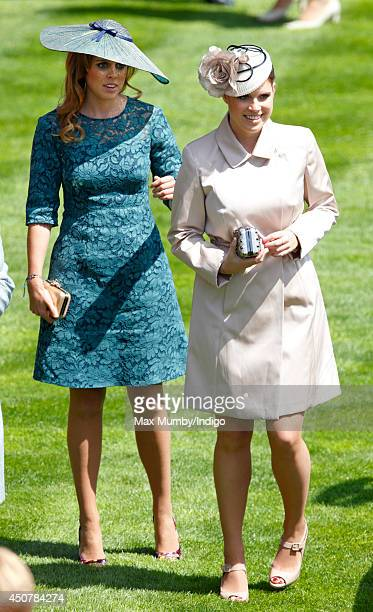 Princess Beatrice of York and Princess Eugenie of York attend Day 1 of Royal Ascot at Ascot Racecourse on June 17 2014 in Ascot England