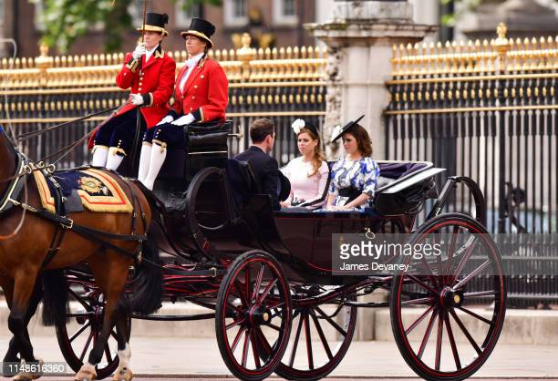 Princess Beatrice of York and Princess Eugenie of York leave Buckingham Palace in a carriage during Trooping The Colour the Queen's annual birthday...