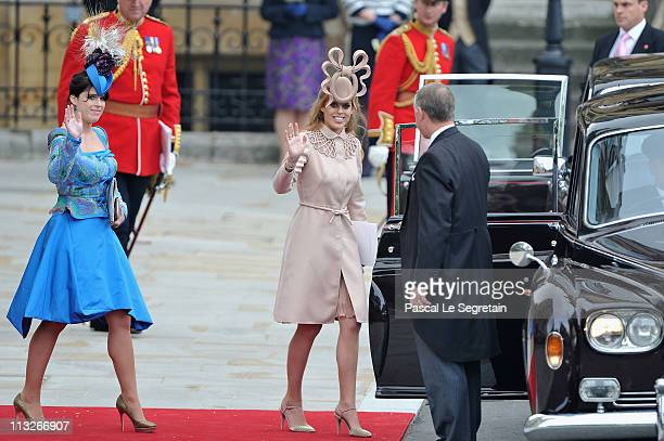 Princess Beatrice of York and Princess Eugenie of York prepare to make the journey by carriage procession to Buckingham Palace following the Royal...