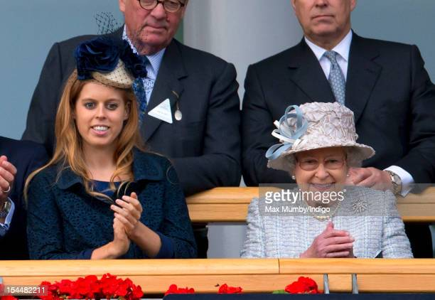 Princess Beatrice of York and Queen Elizabeth II watch Frankel enter the winner's enclosure after winning The QIPCO Champion Stakes at the QIPCO...