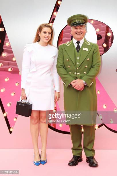 Princess Beatrice of York poses with the Harrods Green Man at the Summer Party at the VA in partnership with Harrods at the Victoria and Albert...