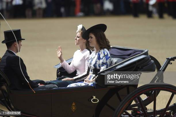 Princess Beatrice of York Princess Eugenie of York and Jack Brooksbank arrive in a horse drawn carriage in Horseguards Parade for Trooping the Colour...