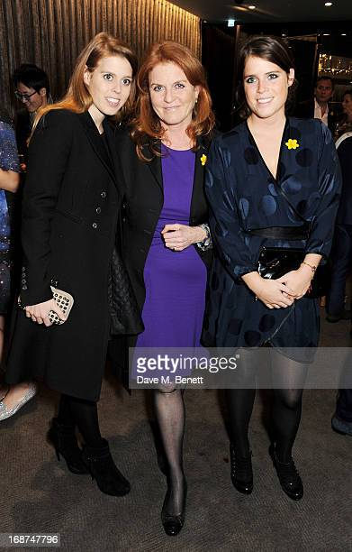 Princess Beatrice of York Sarah Ferguson Duchess of York and Princess Eugenie of York attend the launch of Samsung's NX Smart Camera at a charity...