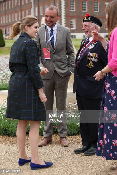 Princess Beatrice of York speaks with DDay and Operation Market Garden veteran Joe Cattini at the DDay 75 Garden during her visit to the RHS Chelsea...