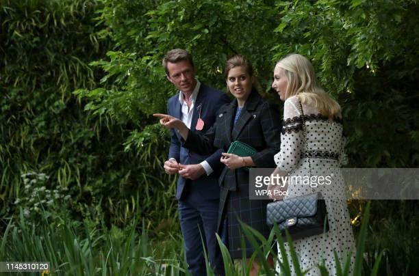 Princess Beatrice of York with her friend Alice NaylorLeyland speak with garden designer Andrew Duff in the Savills David Harbour Garden during their...