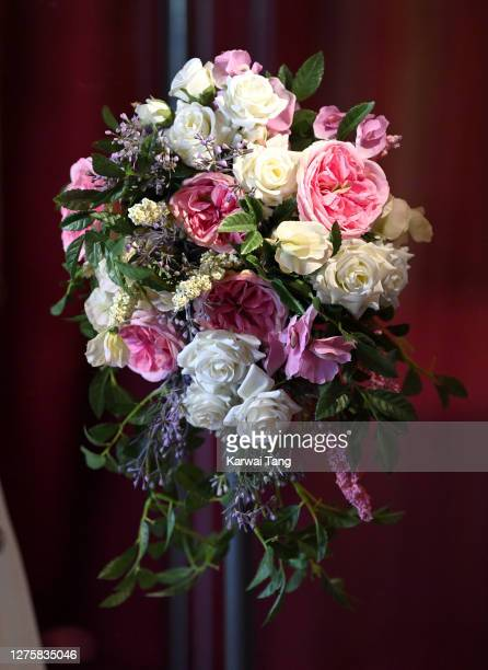 Princess Beatrice of York's wedding bouquet and wedding dress on display at Windsor Castle on September 23, 2020 in Windsor, England. Princess...