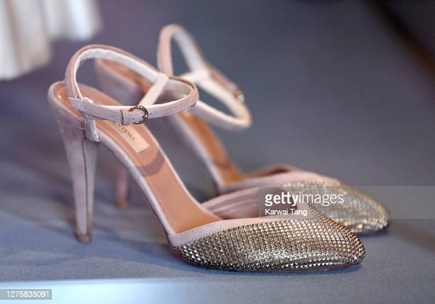 Princess Beatrice of York's wedding shoes and wedding dress on display at Windsor Castle on September 23, 2020 in Windsor, England. Princess Beatrice...