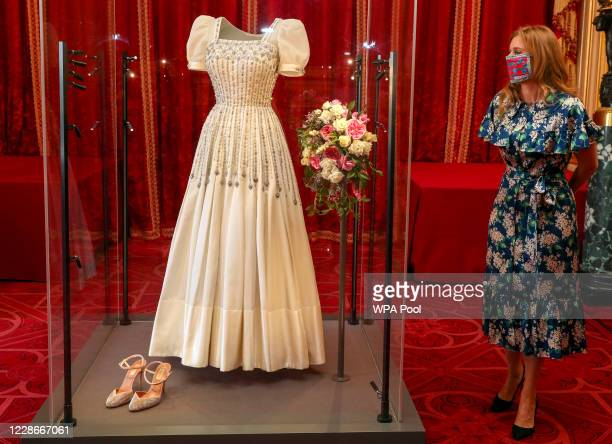 Princess Beatrice poses alongside her wedding dress as it goes on display at Windsor Castle on September 23, 2020 in Windsor, England. Princess...