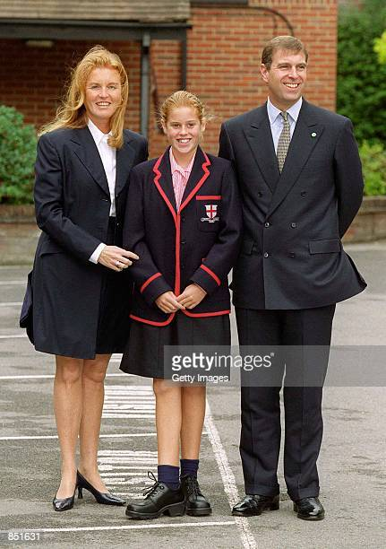 Princess Beatrice poses with her parents the Duke and Dutches of York on her first day of school at St George's September 6 2000 in Ascot England