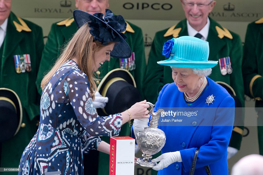 Princess Beatrice presents Queen Elizabeth II with the trophy, after her horse Dartmouth won The Hardwick Stakes, on day 5 of Royal Ascot at Ascot Racecourse on June 18, 2016 in Ascot, England.