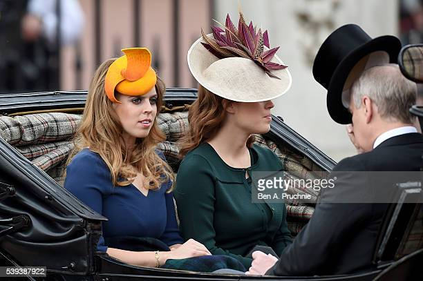 Princess Beatrice Princess Eugenie and Prince Andrew Duke of York sit in a carriage during the Trooping the Colour this year marking the Queen's 90th...