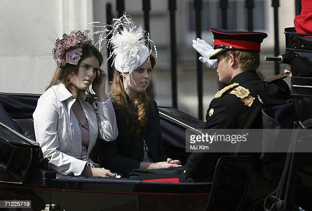 Princess Beatrice Princess Eugenie and Prince Harry leave Buckingham Palace by carriage for trooping of The Queen's Colour of First Battalion...