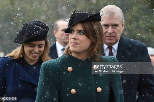 Princess Beatrice Princess Eugenie and their father the Duke of York leave after attending a church service at St Lawrence Church Castle Rising...