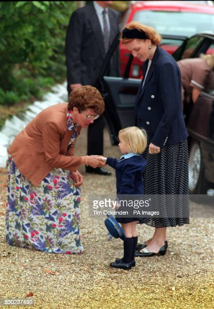 Princess Beatrice shakes hands with headmistress Jane Woodley when she arrived with her mother, the Duchess of York for her first day at Upton house...