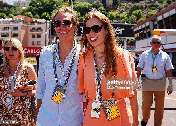 Princess Beatrice walks in the pitlane with her boyfriend Dave Clark before the Monaco Formula One Grand Prix at the Monte Carlo Circuit on May 29...