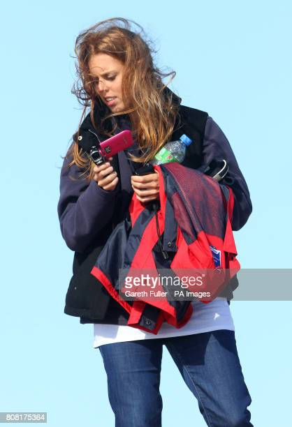 Princess Beatrice watches her boyfriend Dave Clark take part in Sir Richard Branson's kiteboarding attempt across the English Channel