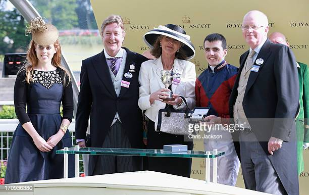 Princess Beatrice who presented The King George V Stakes Cup to Julia and Jon Aisbitt owners of Elidor ridden by Martin Harley and trainer Mick...