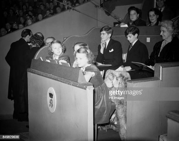 Princess Beatrix and Princess Irene daughters of Queen Juliana and Prince Bernhard of the Netherlands watch the Bertram Mills Circus at Olympia in...