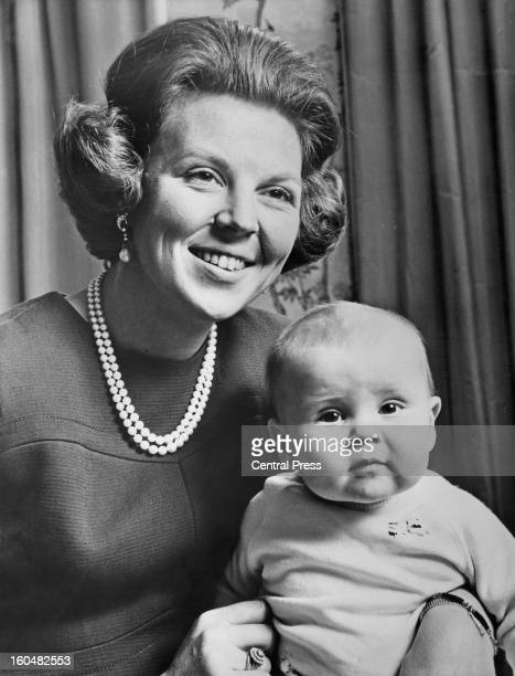 Princess Beatrix, Crown Princess of Holland, and heir to the throne, photographed on the occasion of her 30th birthday with her 8 month old son...
