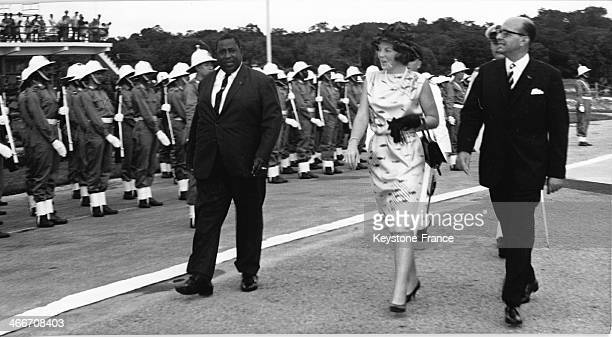 Princess Beatrix inspecting the Guard of Honour with both Surinam Prime Minister Johan Adolf Pengel left and Governor Erwin De Vries on March 4 1965...