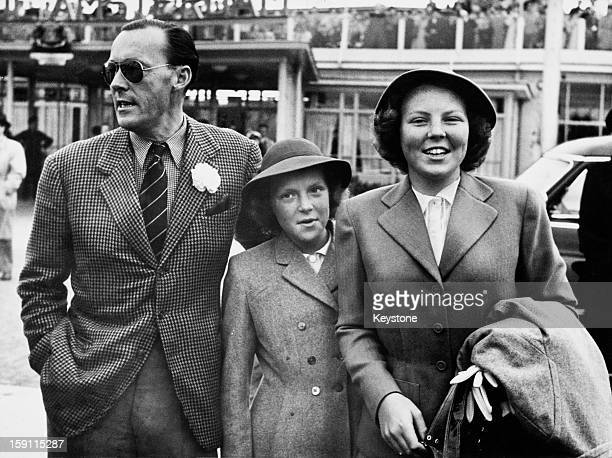 Princess Beatrix , later Queen Beatrix of the Netherlands, and her sister Princess Irene arrive at Amsterdam airport after a holiday in Canada and...