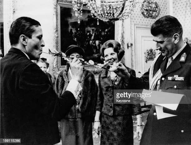 Princess Beatrix later Queen Beatrix of the Netherlands and her fiance Claus van Amsberg receive a wedding gift at the Soestdijk Palace Netherlands...