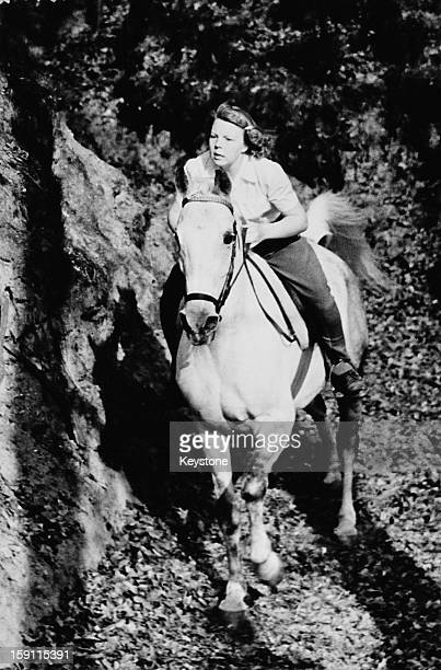 Princess Beatrix, later Queen Beatrix of the Netherlands, during a cross-country ride, April 1952.