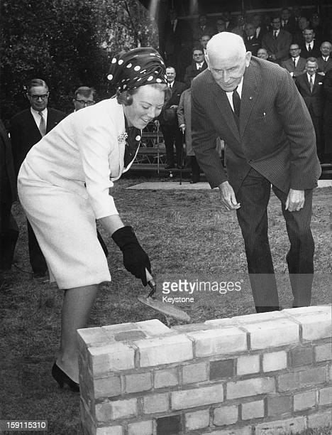 Princess Beatrix, later Queen Beatrix of the Netherlands, lays one of the first bricks of the new European College in Bruges, Belgium, 9th June 1965.
