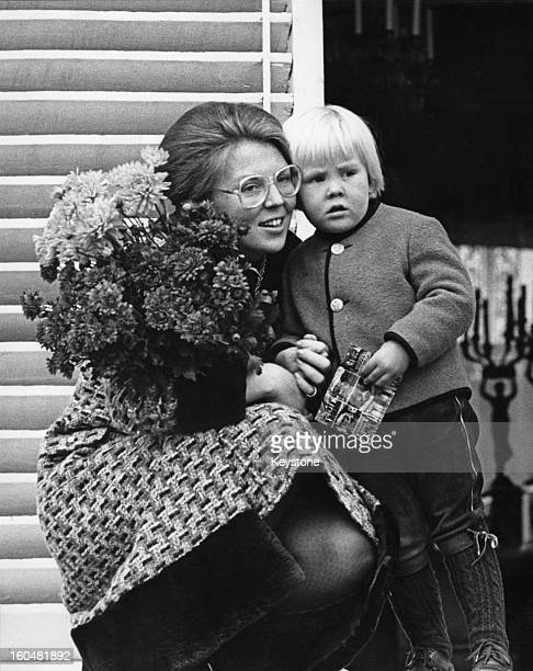 Princess Beatrix of the Netherlands and her eldest son, Willem-Alexander, Prince of Orange, listening to a performance by the Trachter Musik Kapelle...