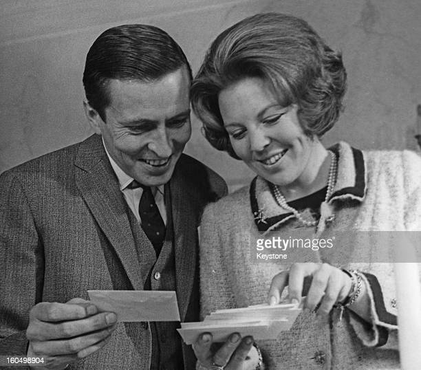 Princess Beatrix of the Netherlands and her fiancee Claus van Amsberg reading good luck telegrams shortly before their wedding 6th March 1966
