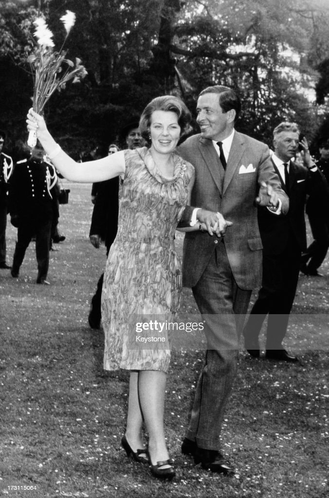 Princess Beatrix of the Netherlands and her fiancee Claus van Amsberg (1926 - 2002) in the grounds of Soestdijk Palace, Utrecht, Netherlands, after they announced their engagement, Netherlands, 28th June 1965.